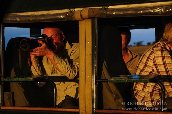 workshop guests working at sunset photographing big cats with wildlife photographer Richard Costin